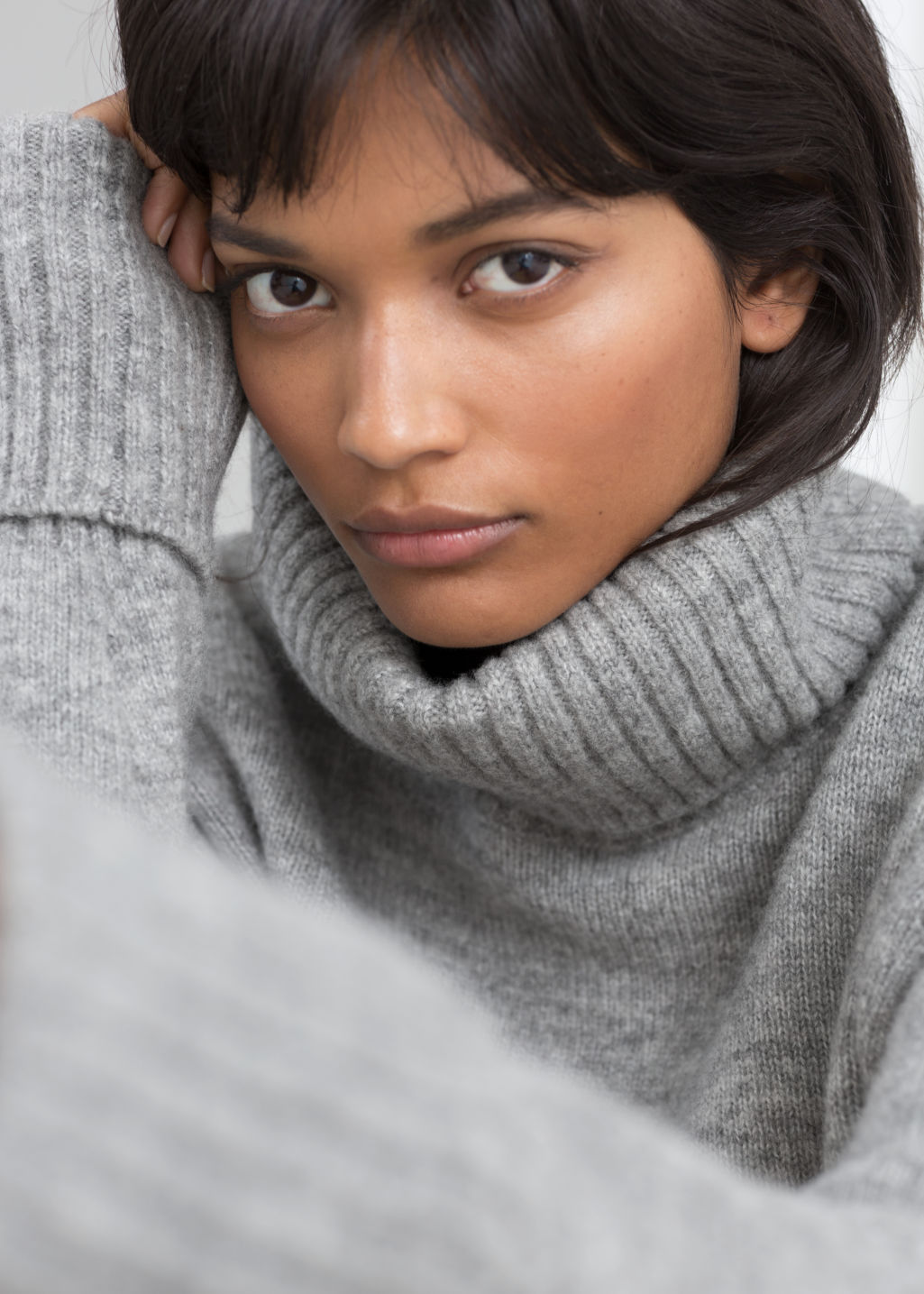 Model front image of Stories turtleneck sweater in grey