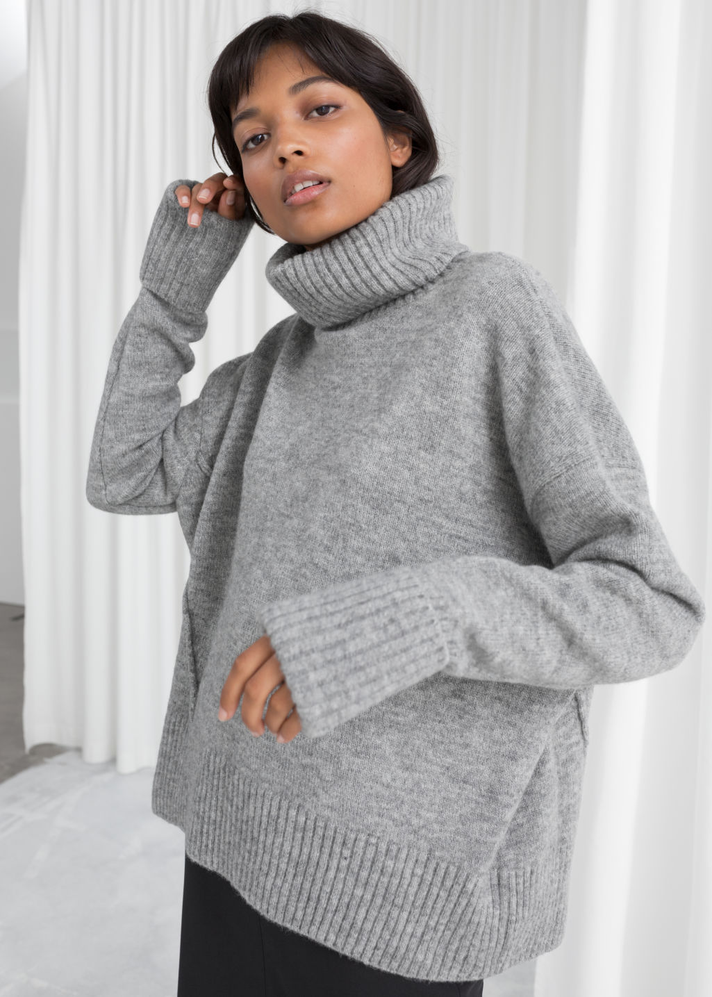 Model back image of Stories turtleneck sweater in grey