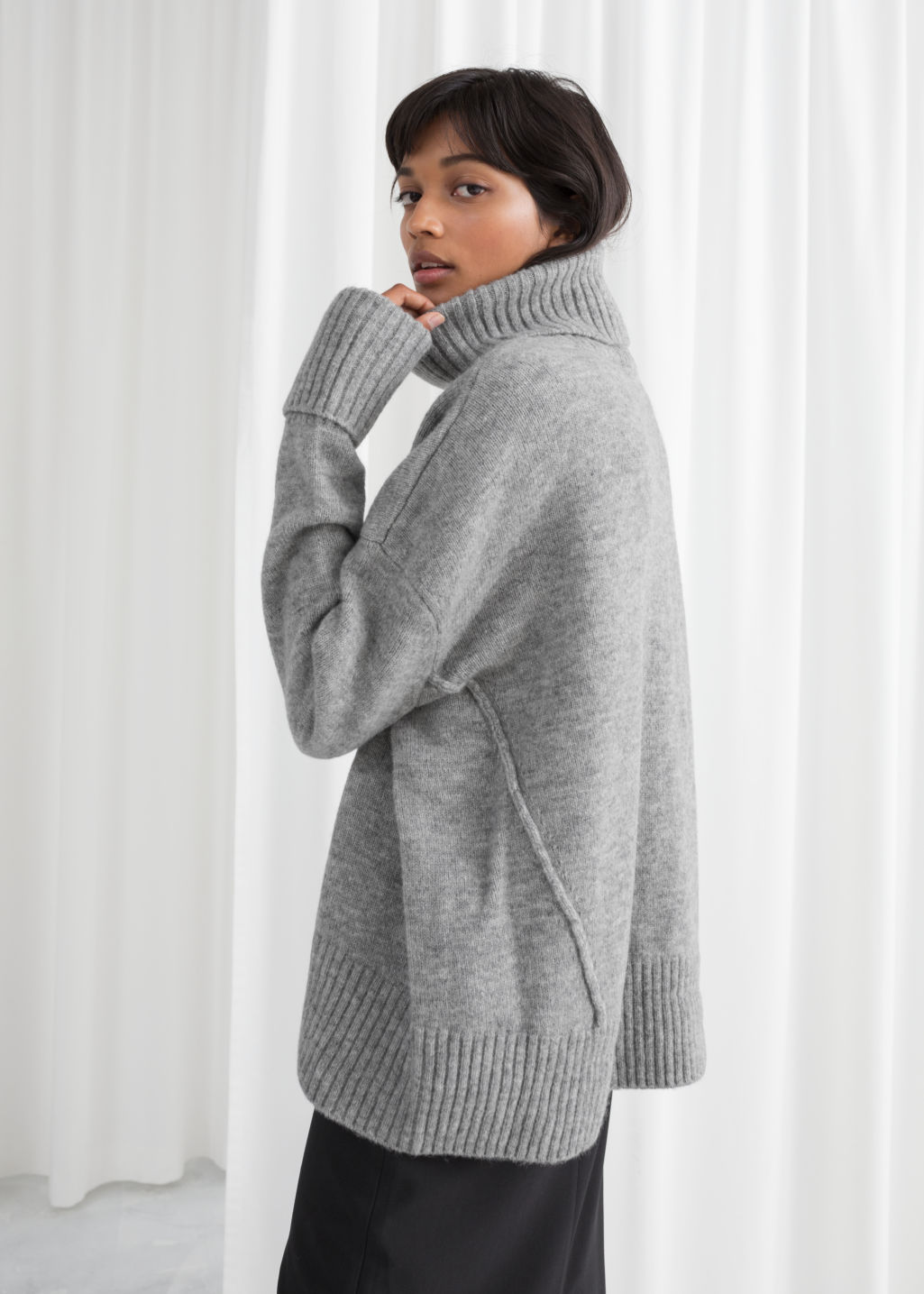 Model back image of Stories wool blend turtleneck sweater in grey