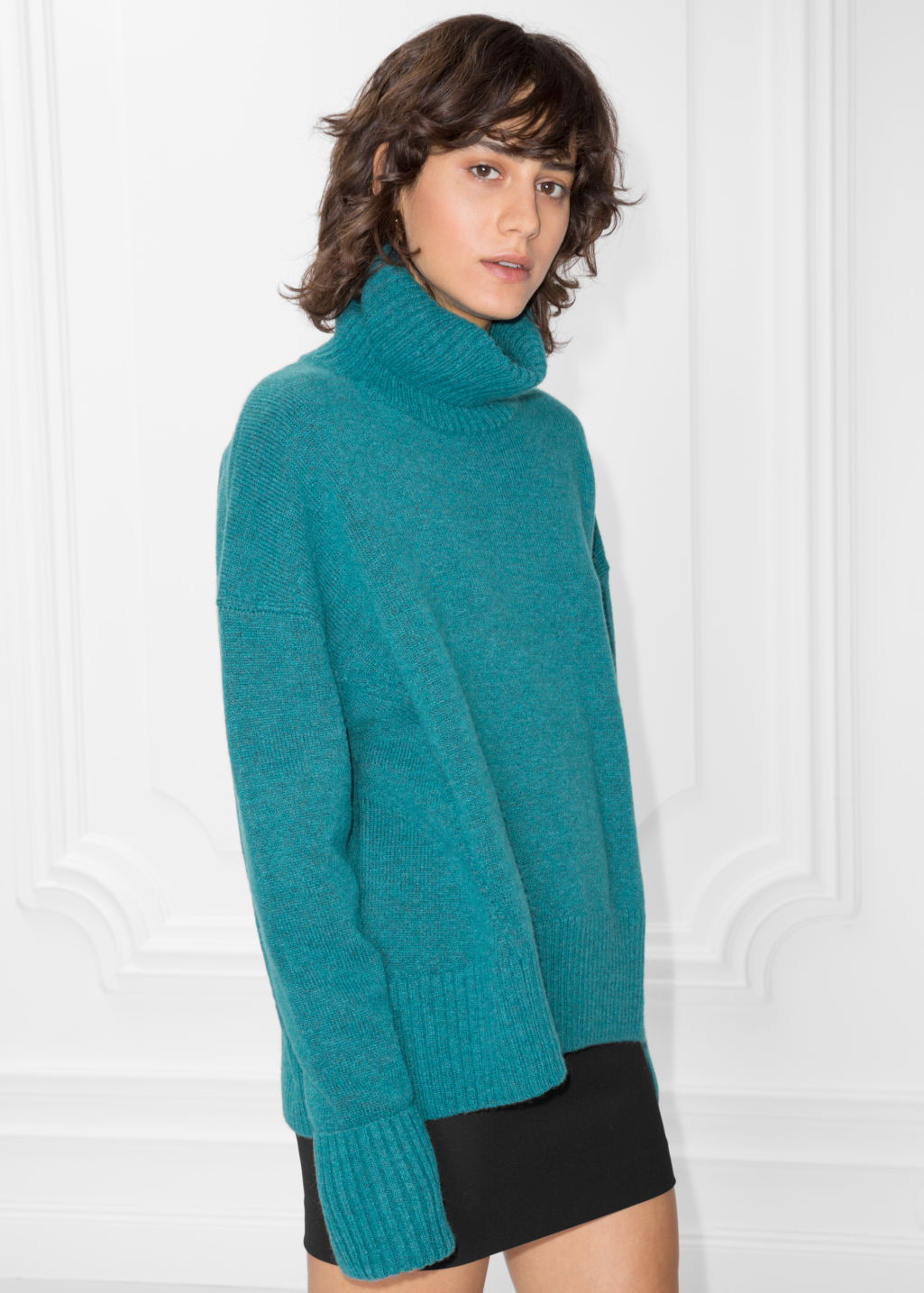 Model front image of Stories turtleneck sweater in turquoise