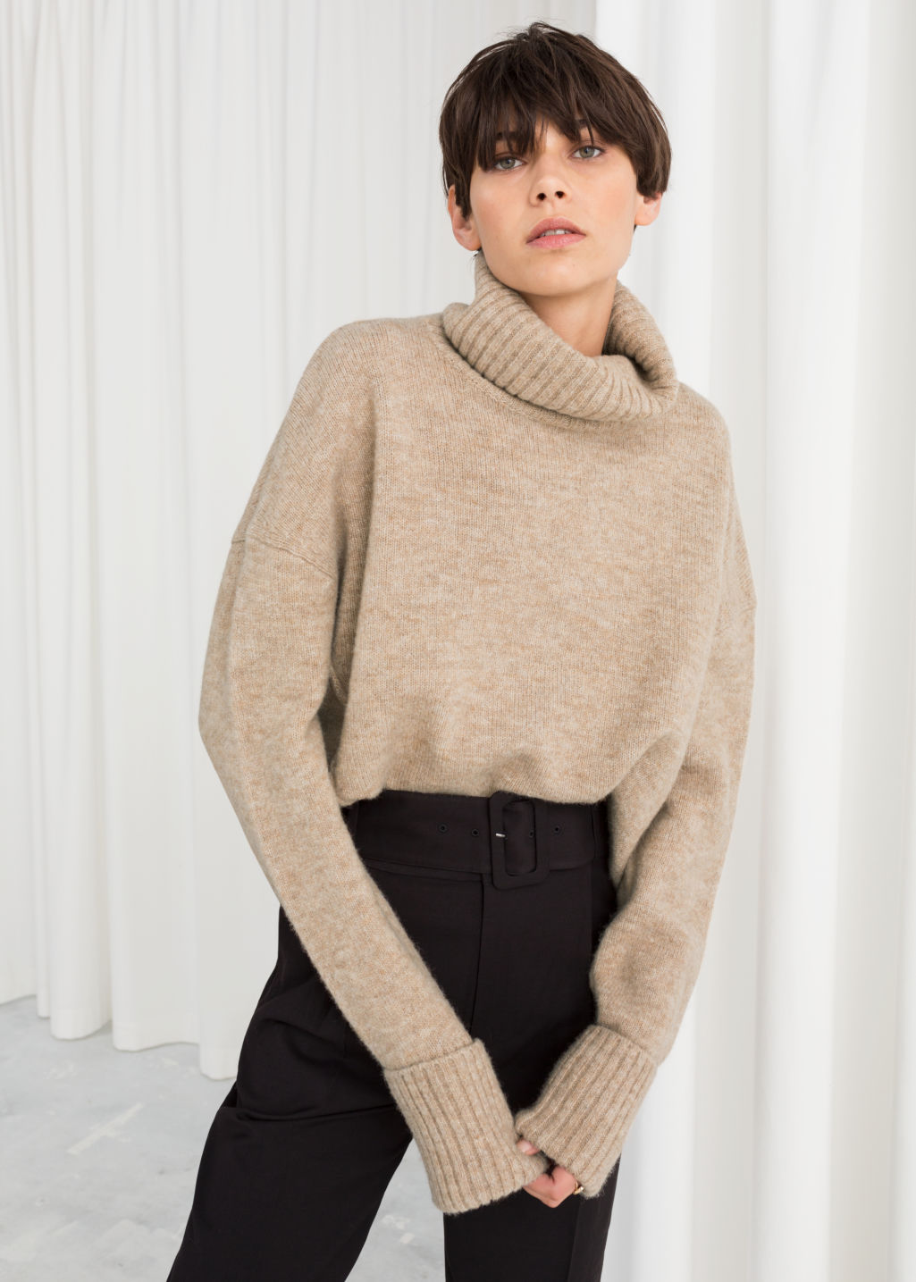 Model front image of Stories wool blend turtleneck sweater in beige