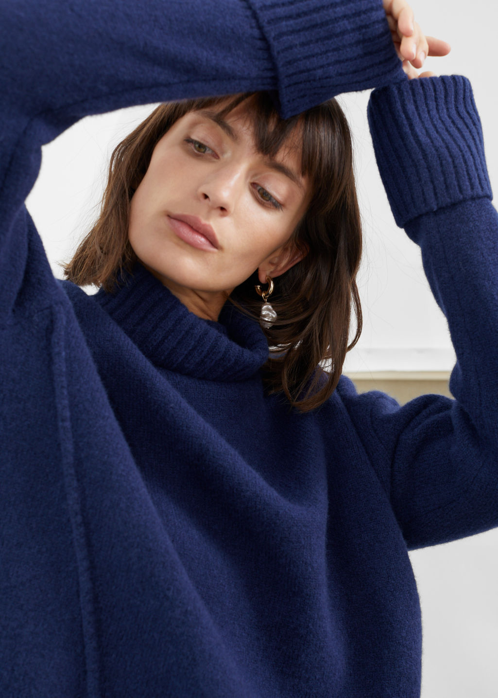 Model front image of Stories wool blend turtleneck sweater in blue