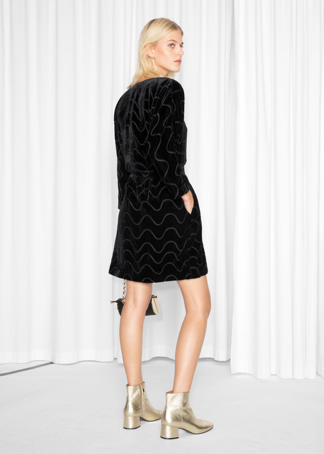 Model Back Image Of Stories Graphic Devoré Wrap Dress In Black