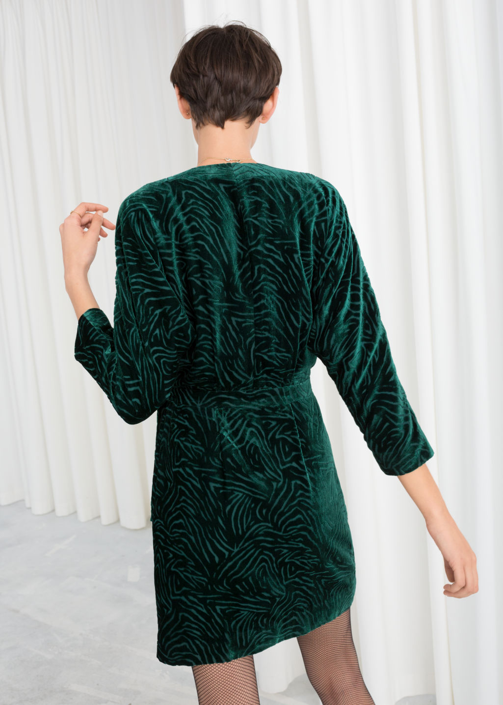 Model back image of Stories velvet wrap dress in turquoise