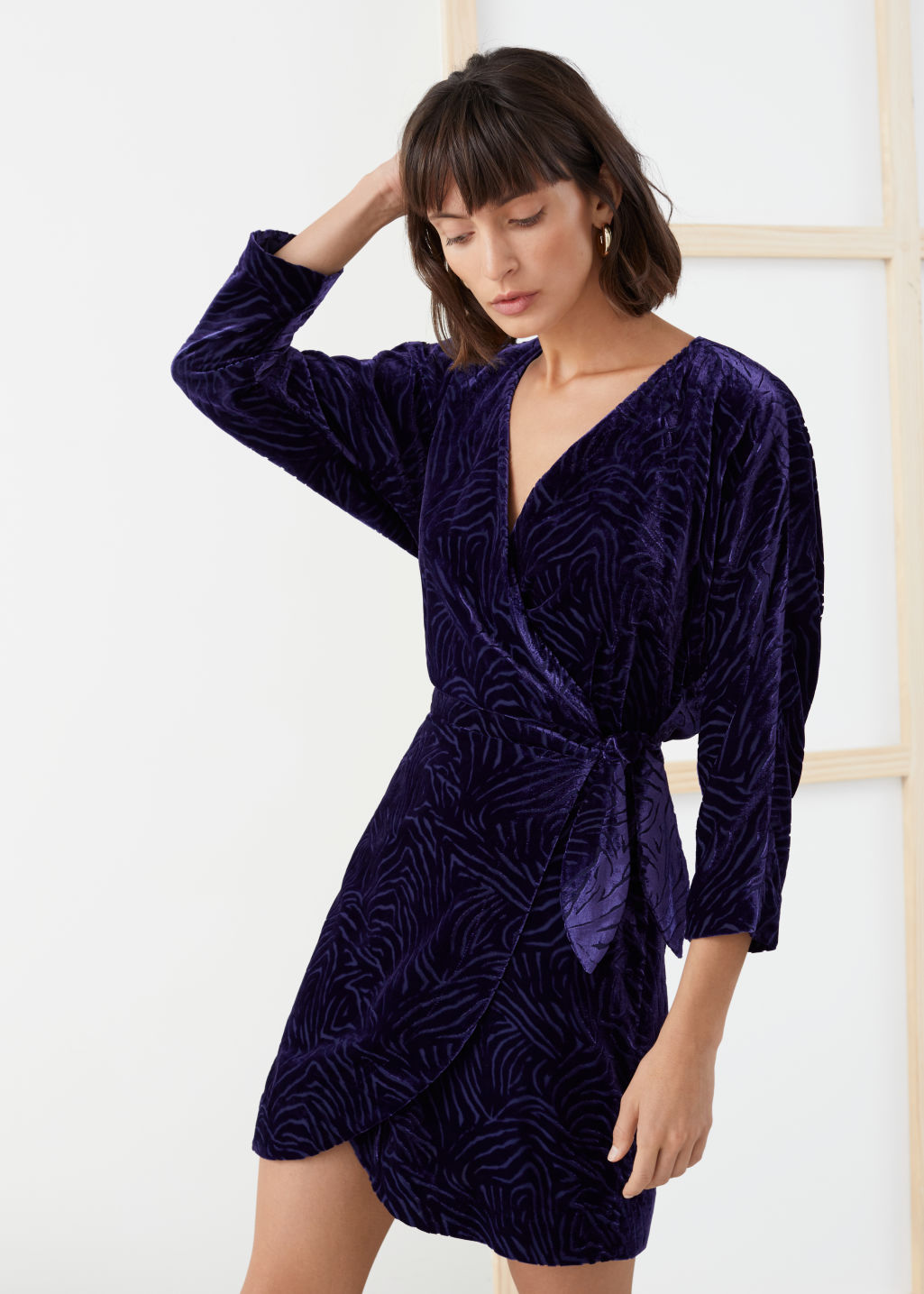 Model front image of Stories velvet wrap dress in purple