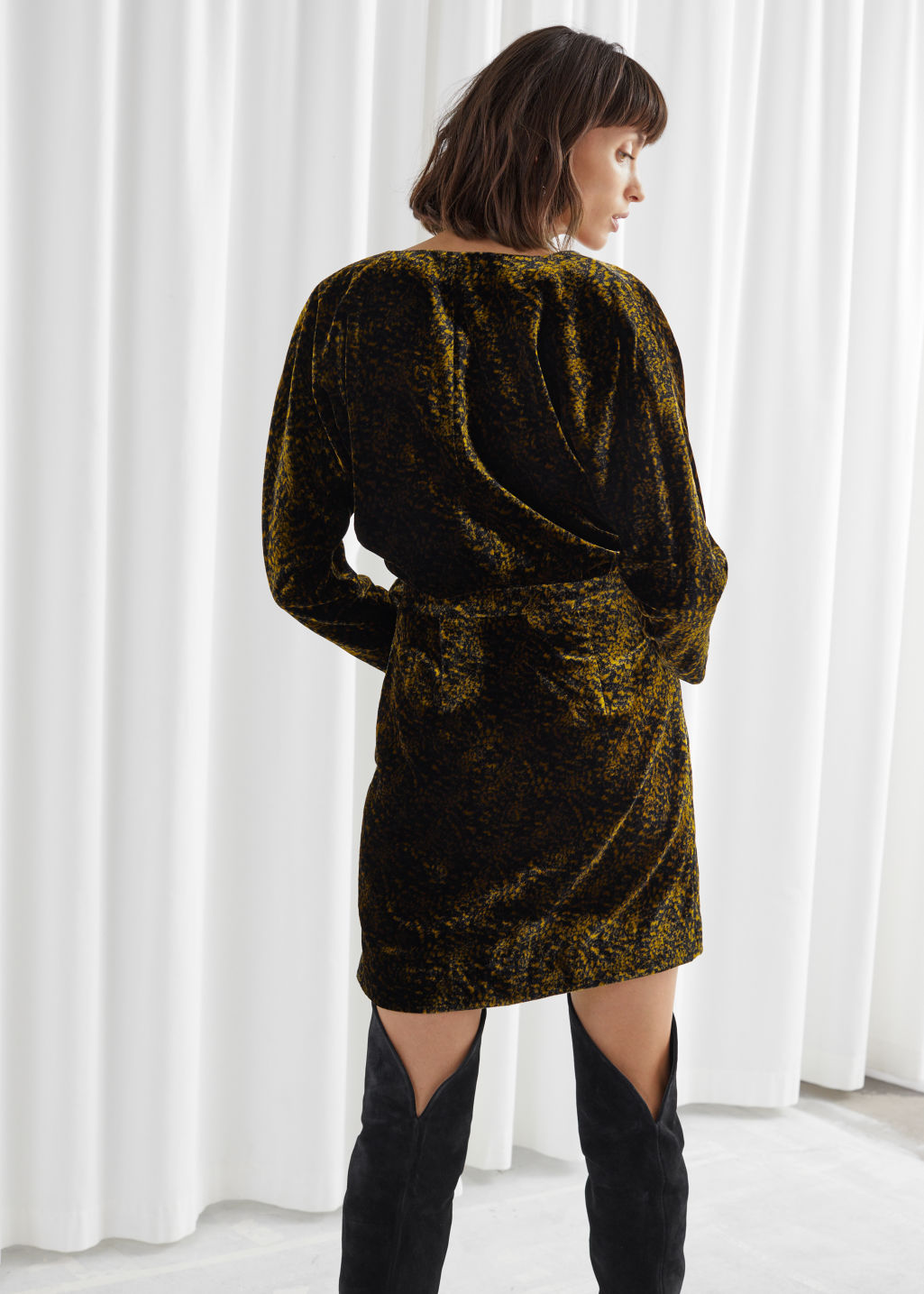 Model back image of Stories velvet wrap dress in black