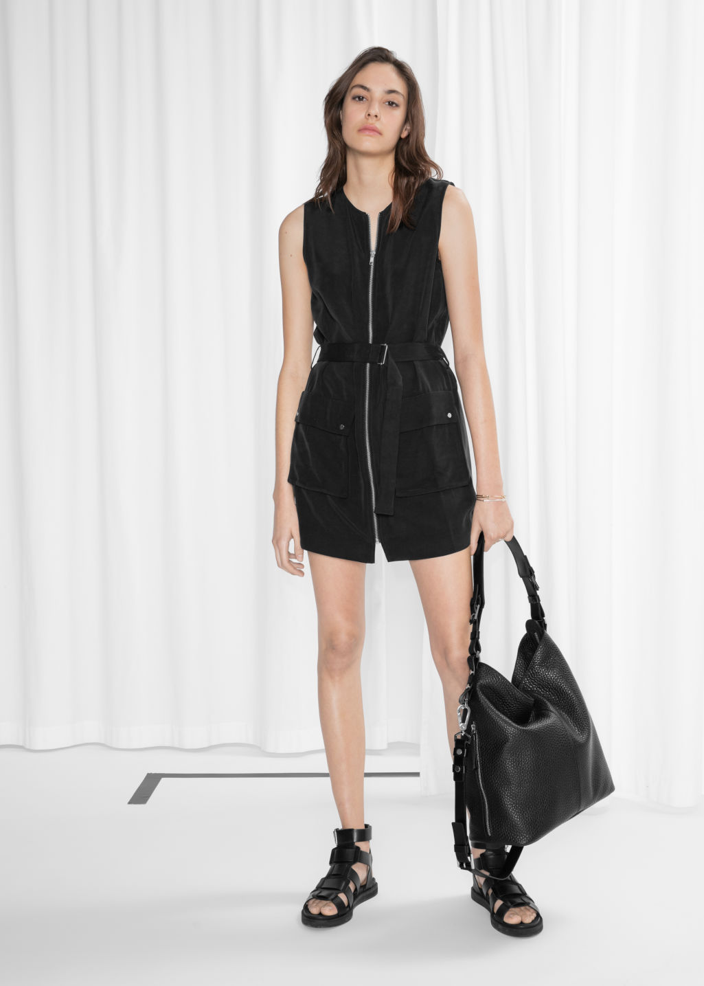 Model front image of Stories belted zip dress in black