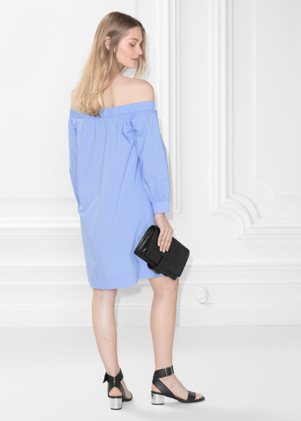 Model back image of Stories off-shoulder dress in blue