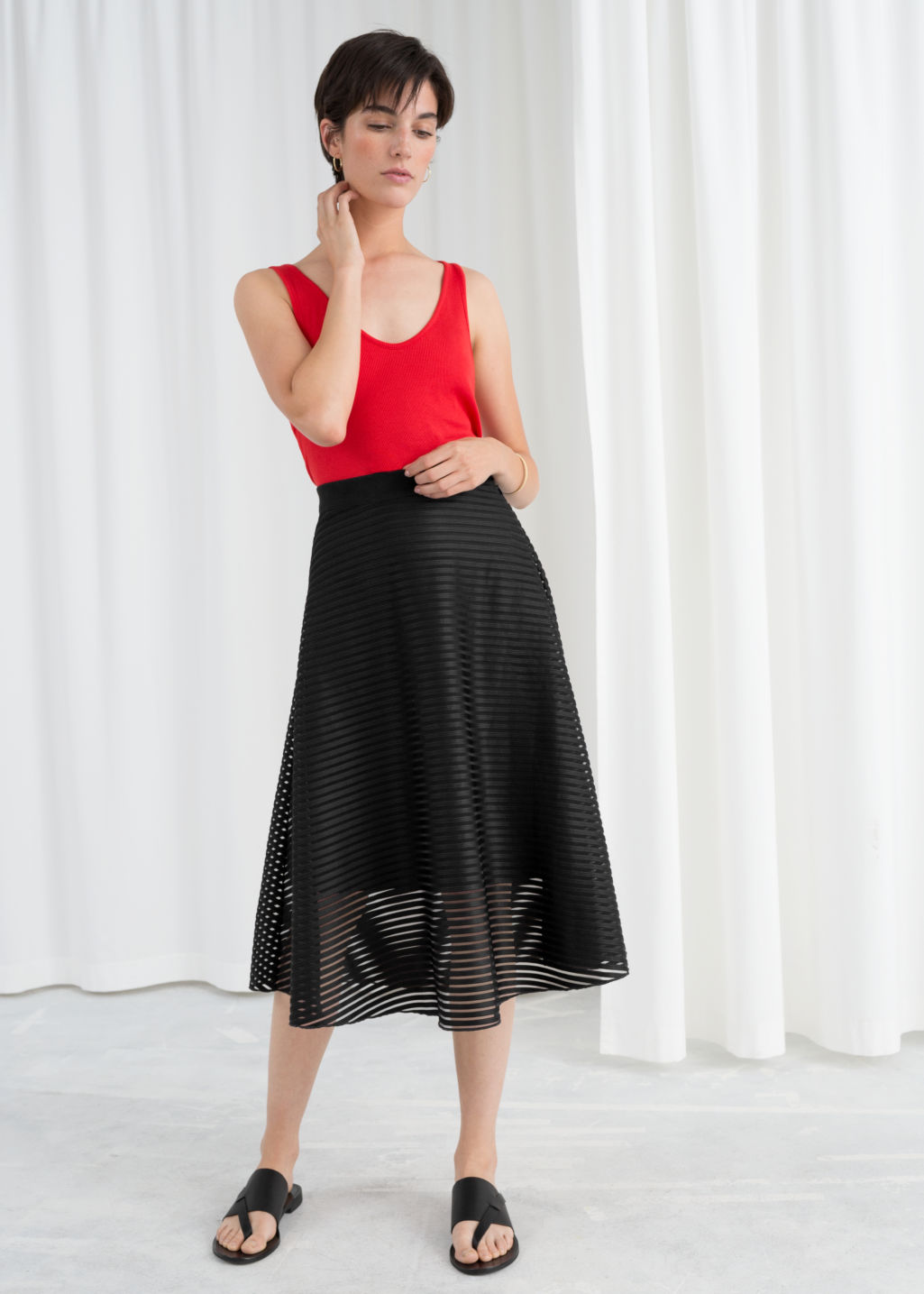 Model front image of Stories striped a-line skirt  in black