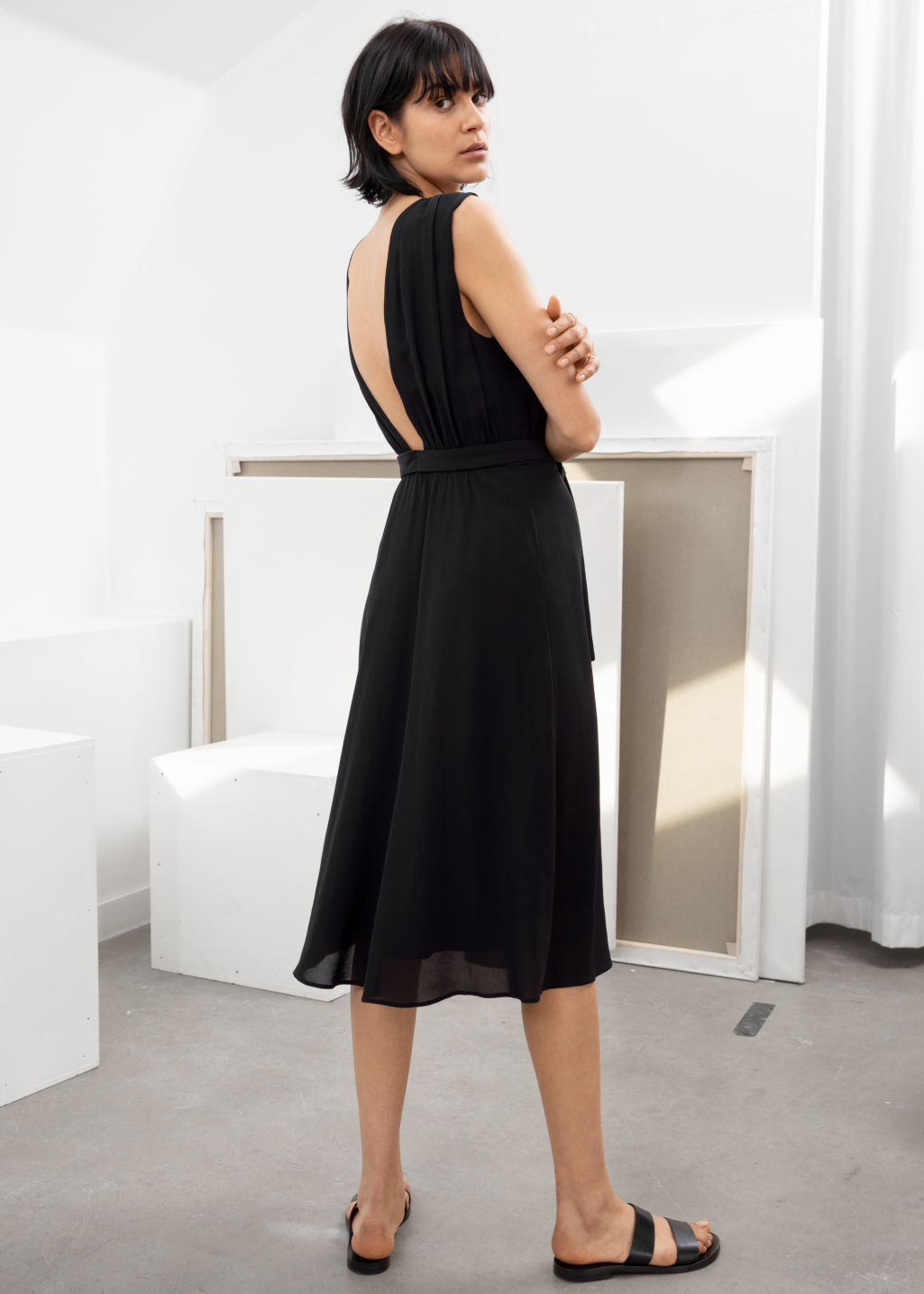 Model back image of Stories cross front dress in black