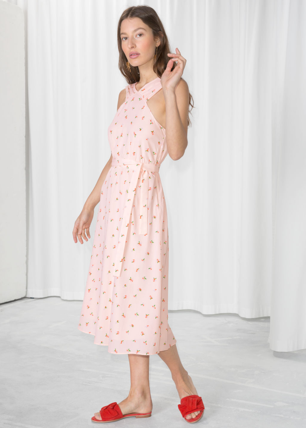 Model front image of Stories cross front dress in pink