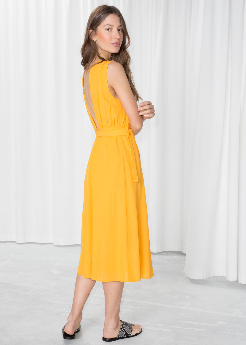 Model front image of Stories cross front dress in yellow