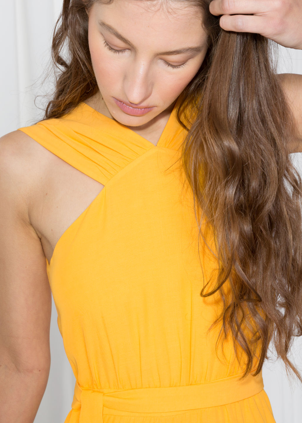 Model back image of Stories cross front dress in yellow