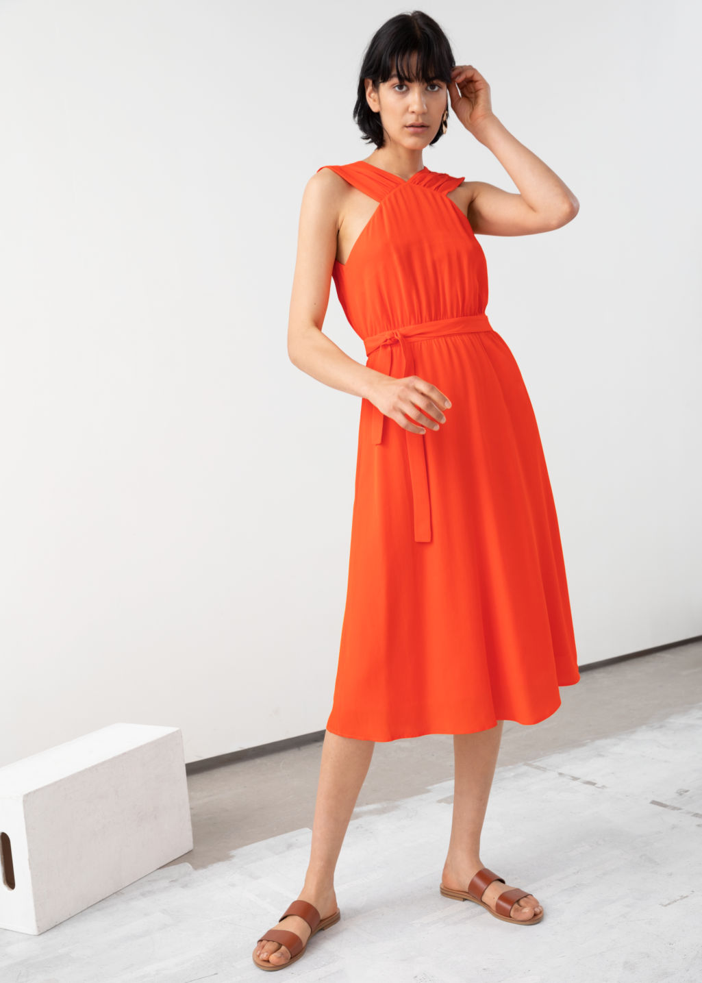 Model front image of Stories cross front dress in orange