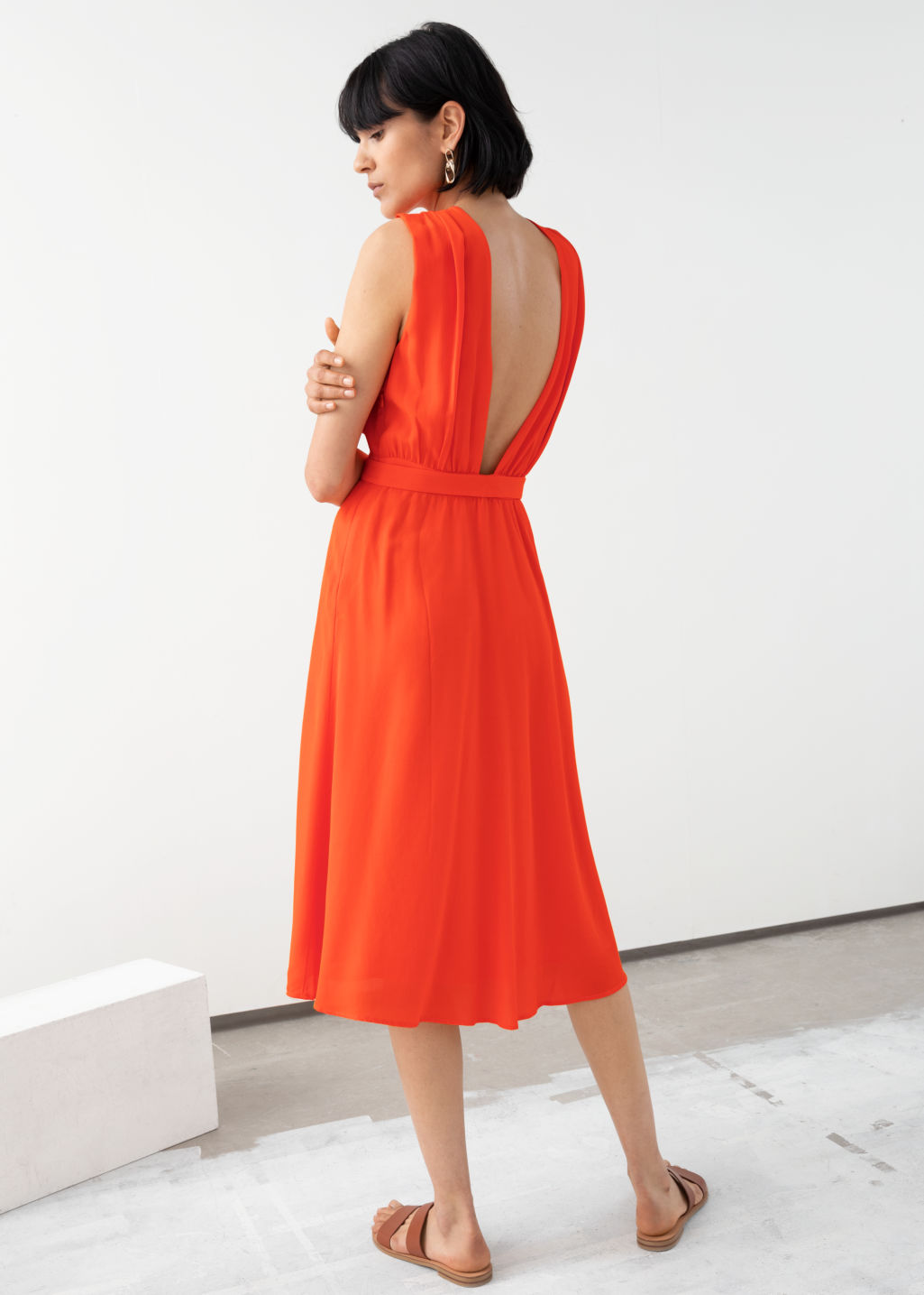 Model back image of Stories cross front dress in orange