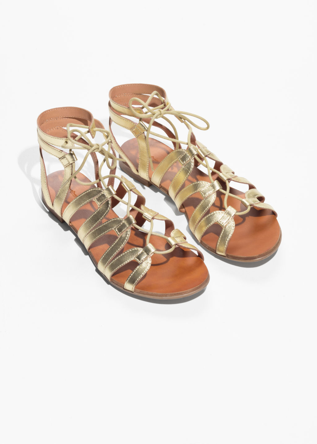 Model back image of Stories lacing sandals in gold