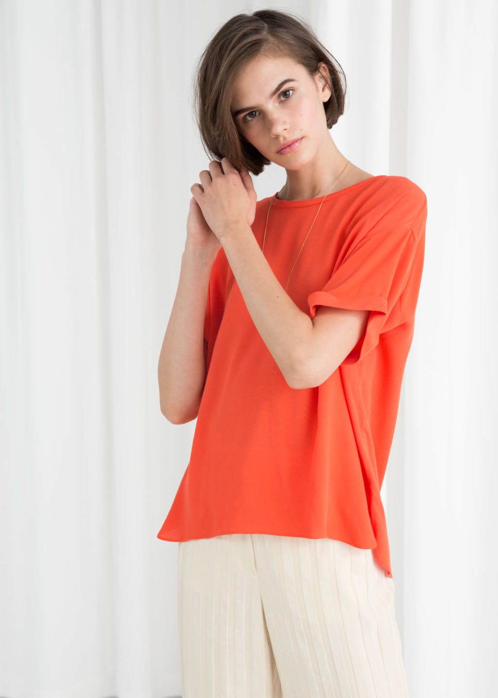 Model front image of Stories boxy fit top in orange