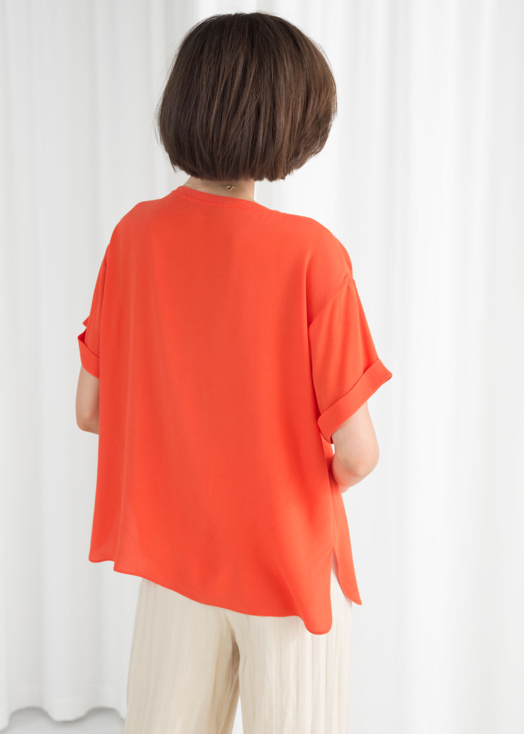 Model back image of Stories boxy fit top in orange
