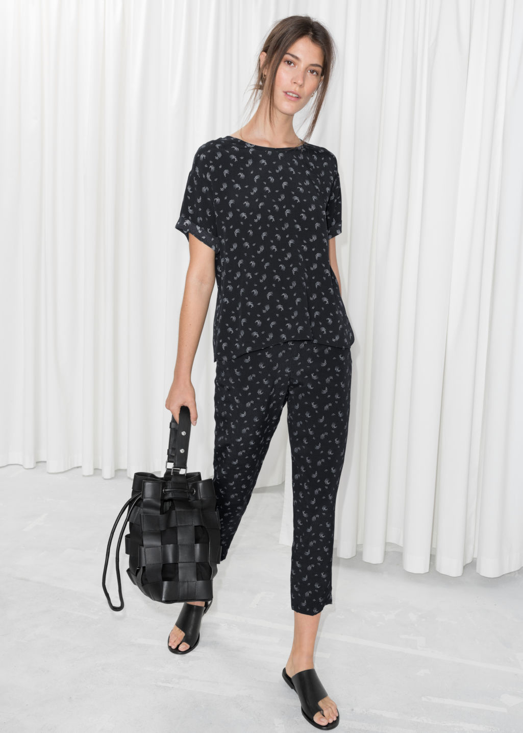 Model front image of Stories cropped trousers in black
