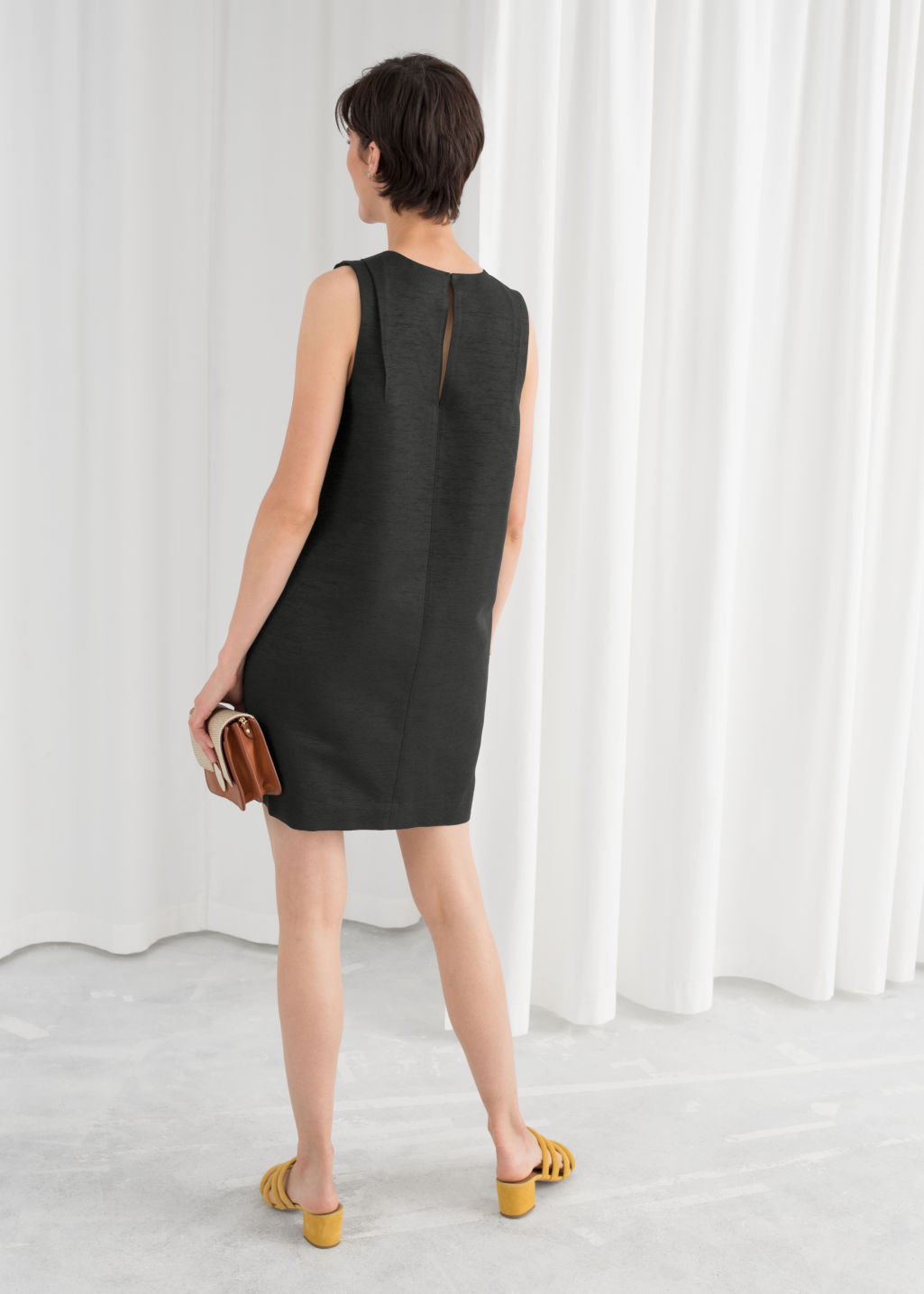 Model back image of Stories sleeveless cocoon dress in black