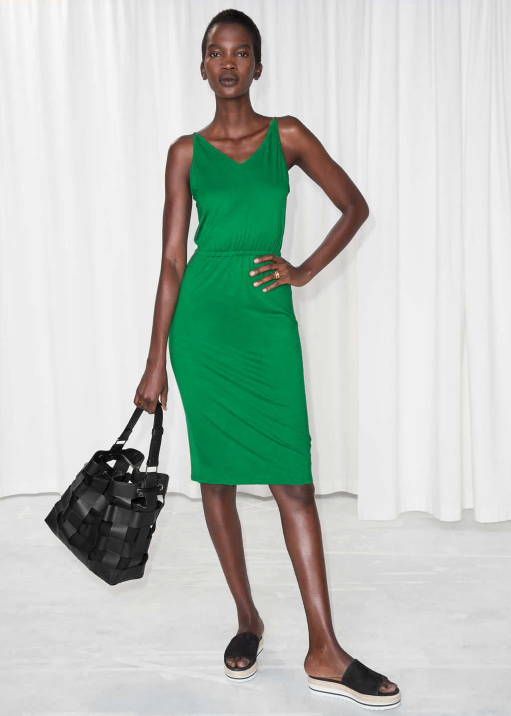 Model front image of Stories tie back dress in green