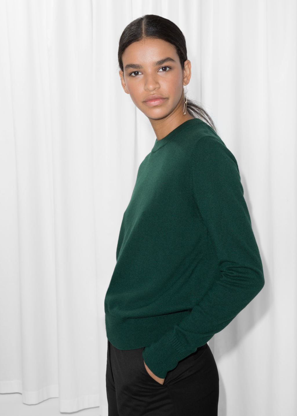 Model front image of Stories cashmere knit sweater in green