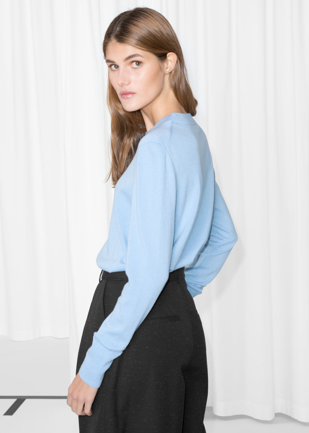 Model back image of Stories cashmere knit sweater in blue