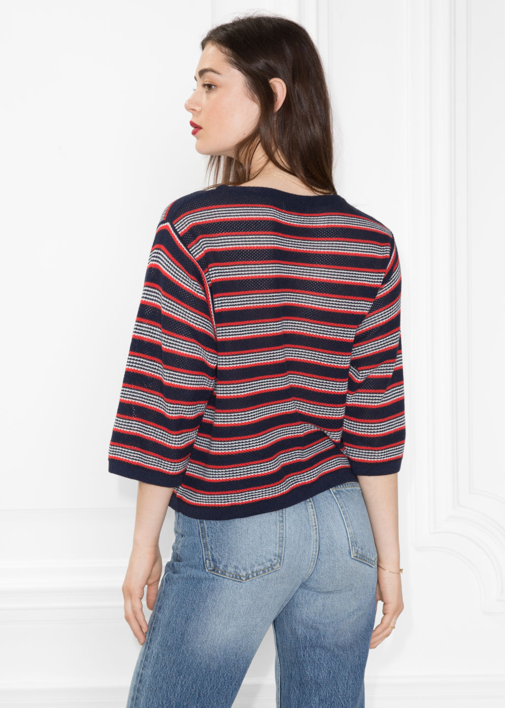 Model back image of Stories striped oversized top  in blue