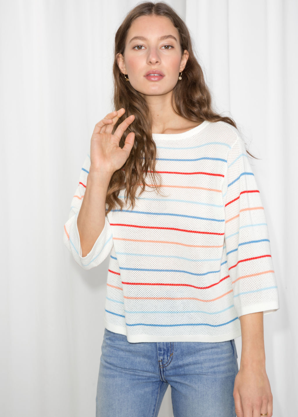 Model front image of Stories striped oversized top  in orange