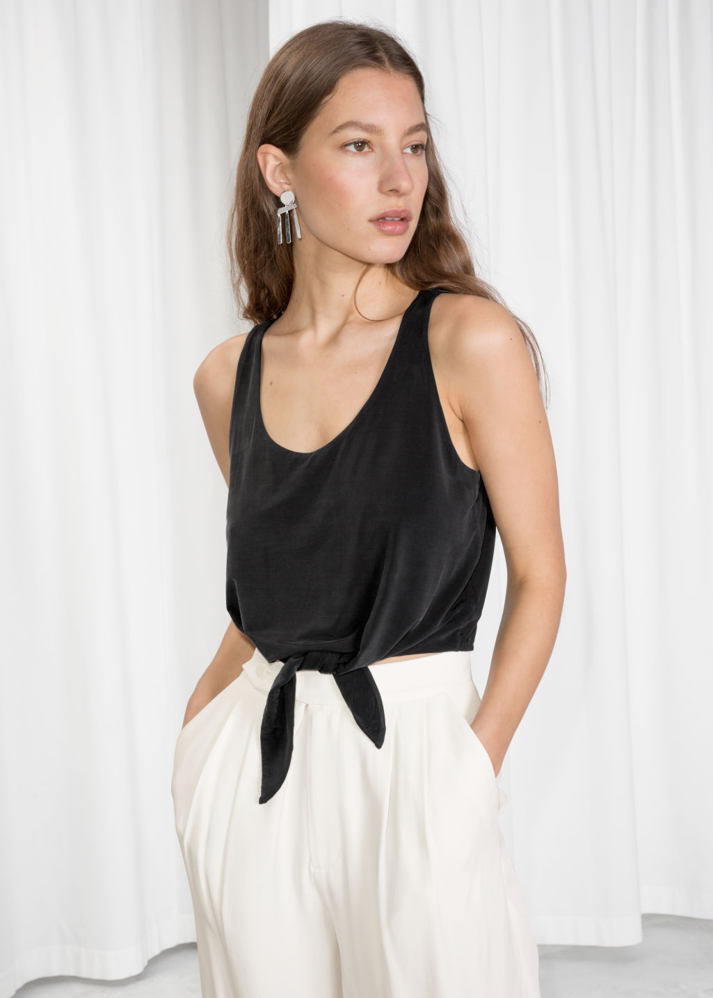 Model front image of Stories cupro tie hem top in black