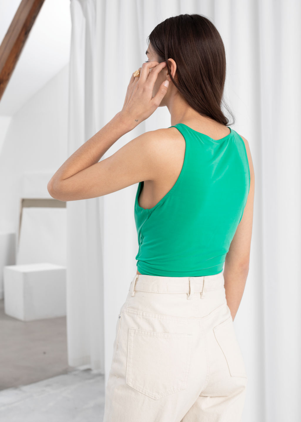 Model back image of Stories cupro tie hem top in green