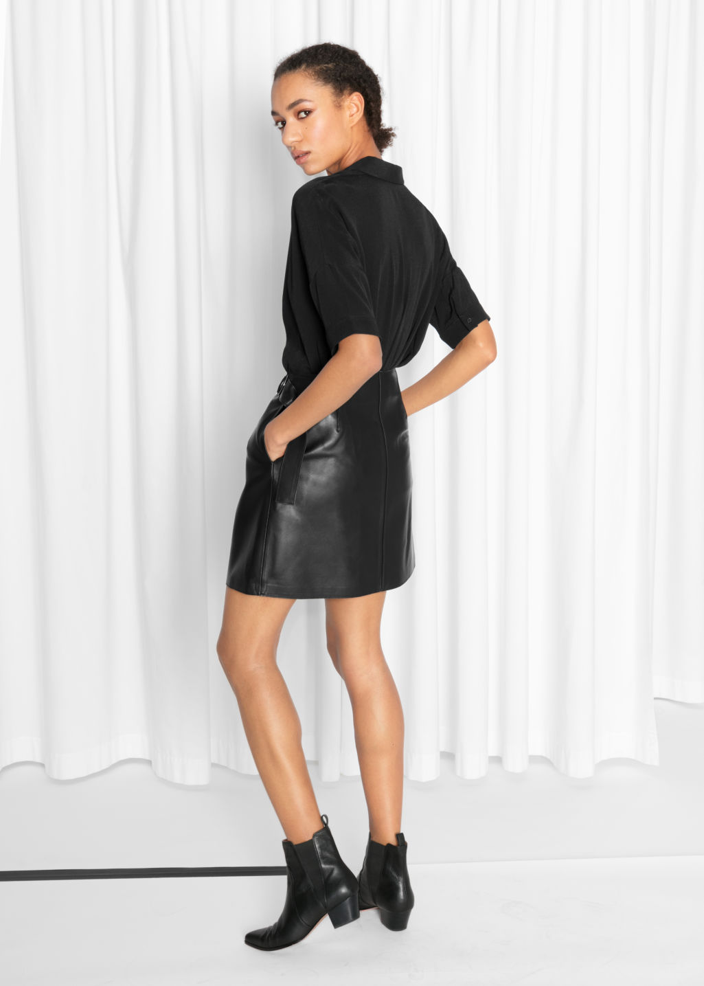 Model back image of Stories wrap leather skirt  in black