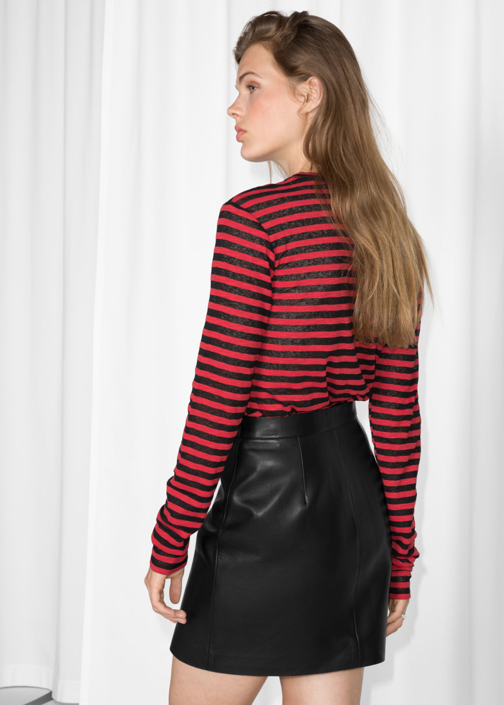 Model back image of Stories sheer striped top in red