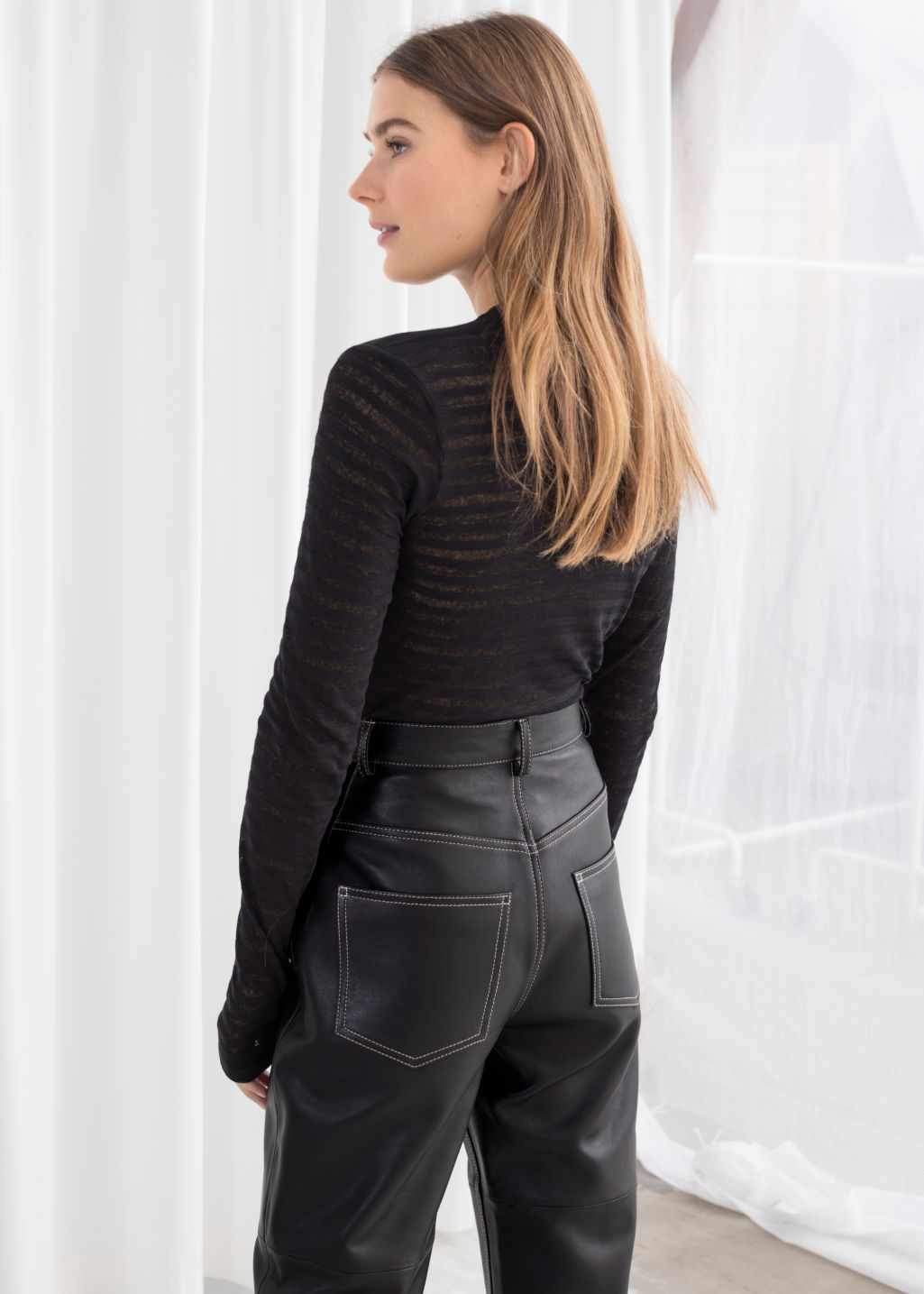 Model back image of Stories sheer striped top in black