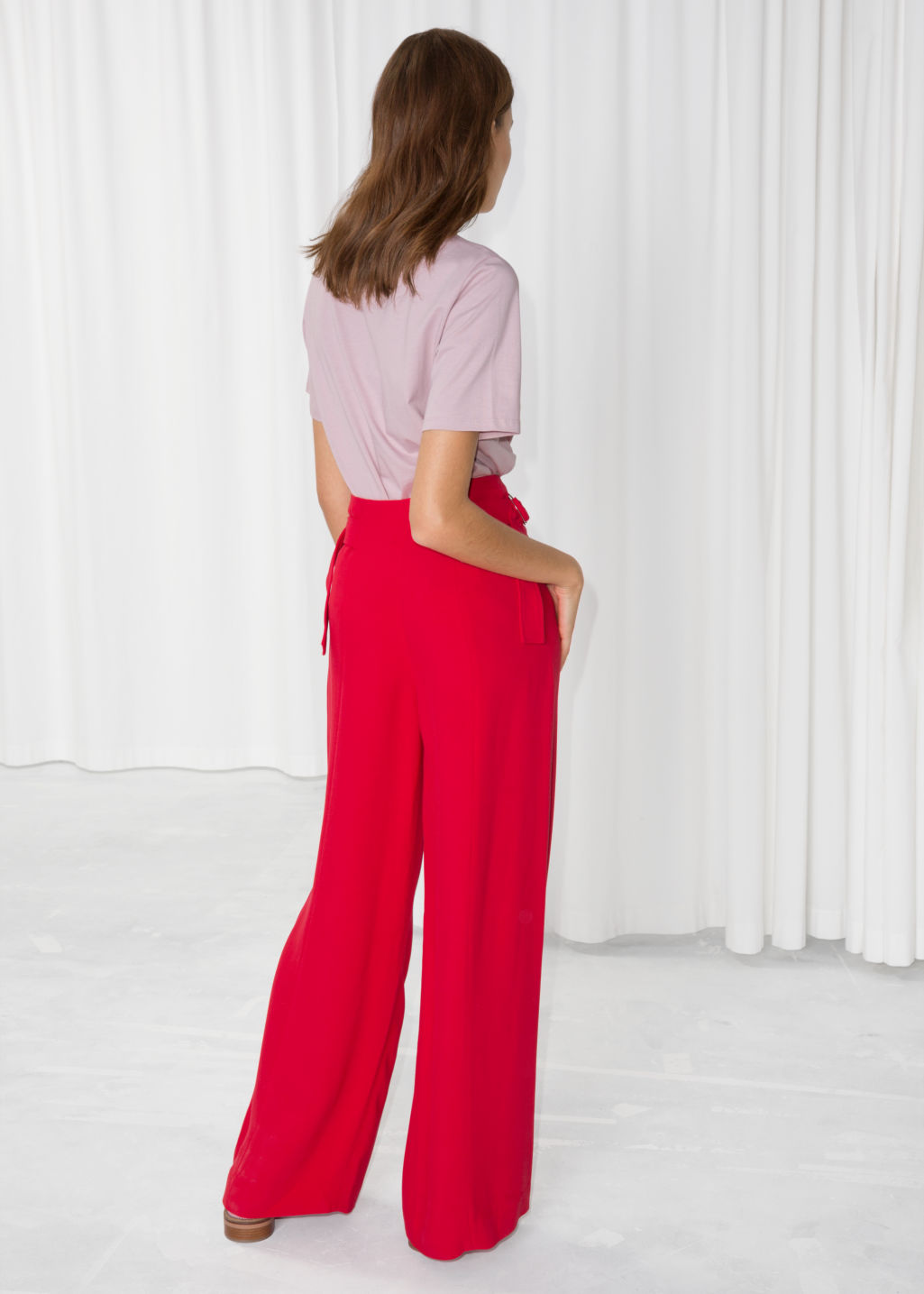 Model back image of Stories belted suit trousers  in red
