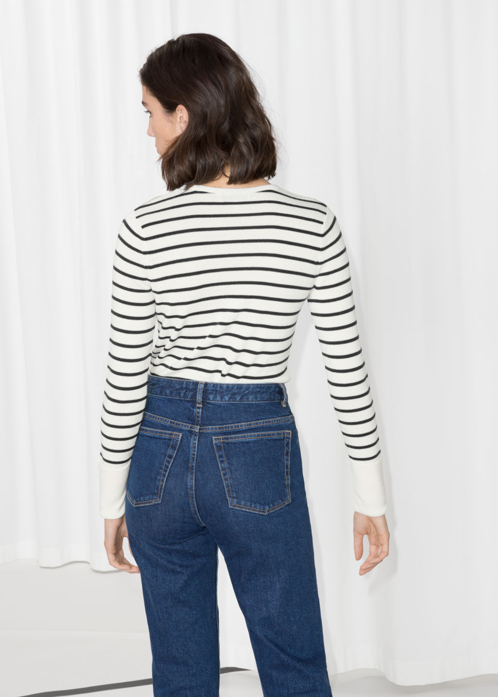 Model back image of Stories nautical sweater in white