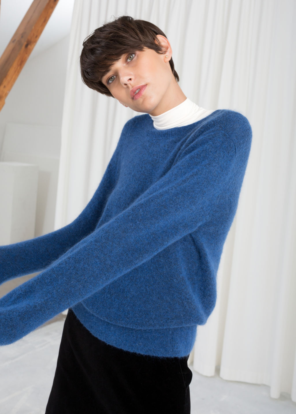 Model front image of Stories wool blend knit sweater in blue