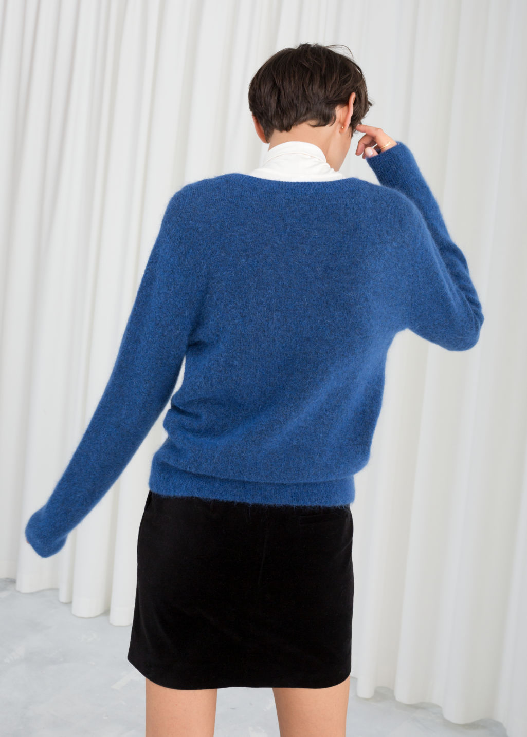 Model back image of Stories wool blend knit sweater in blue