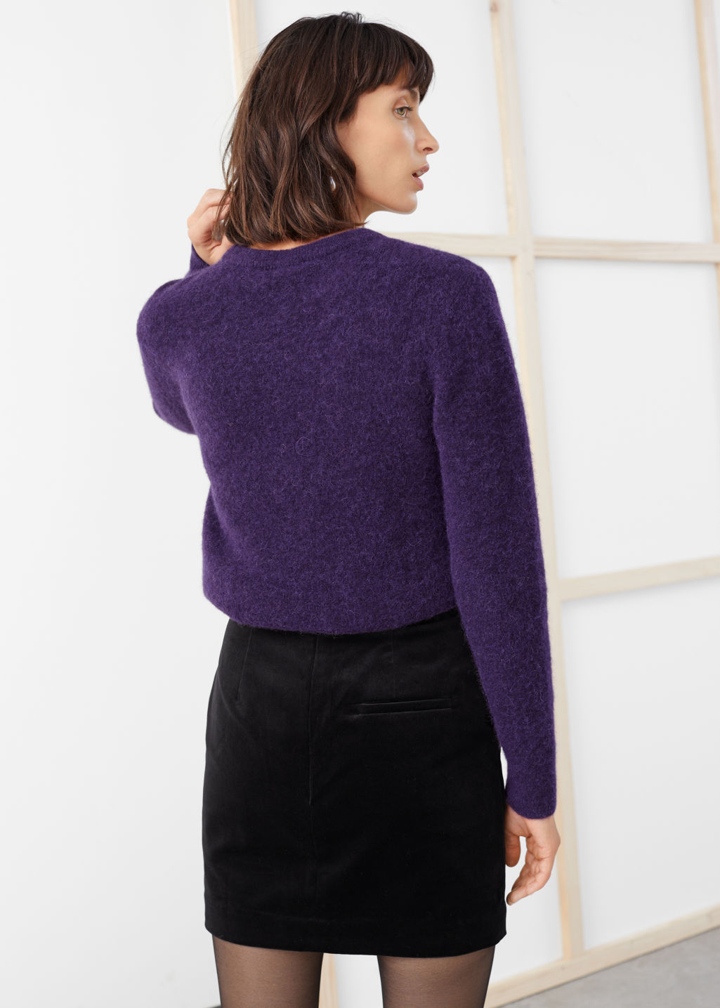 Model back image of Stories wool blend knit sweater in purple