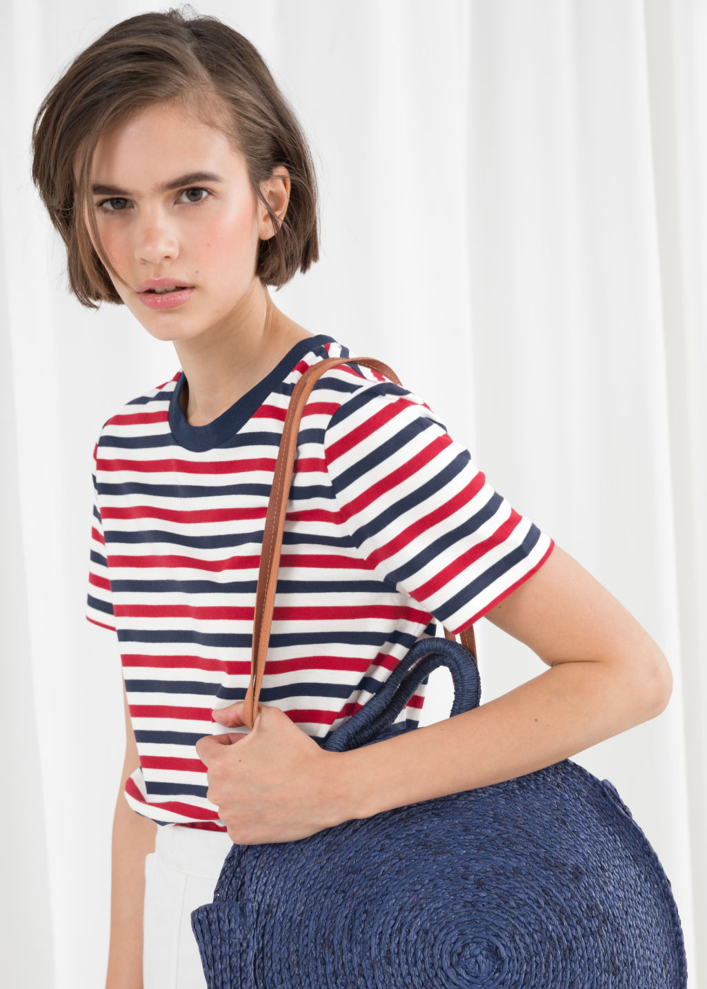 Model front image of Stories striped tee in red
