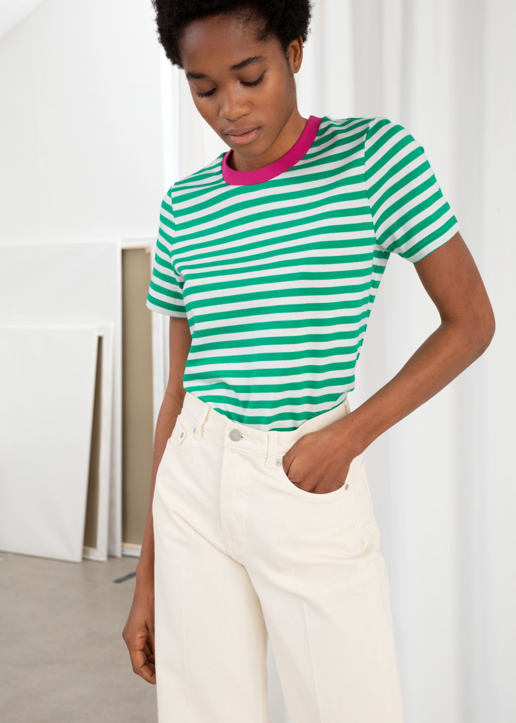 Model front image of Stories striped tee in green