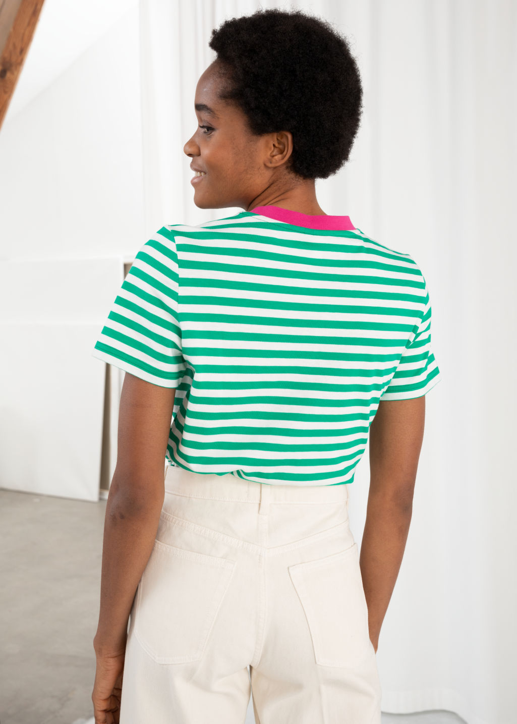 Model back image of Stories striped tee in green