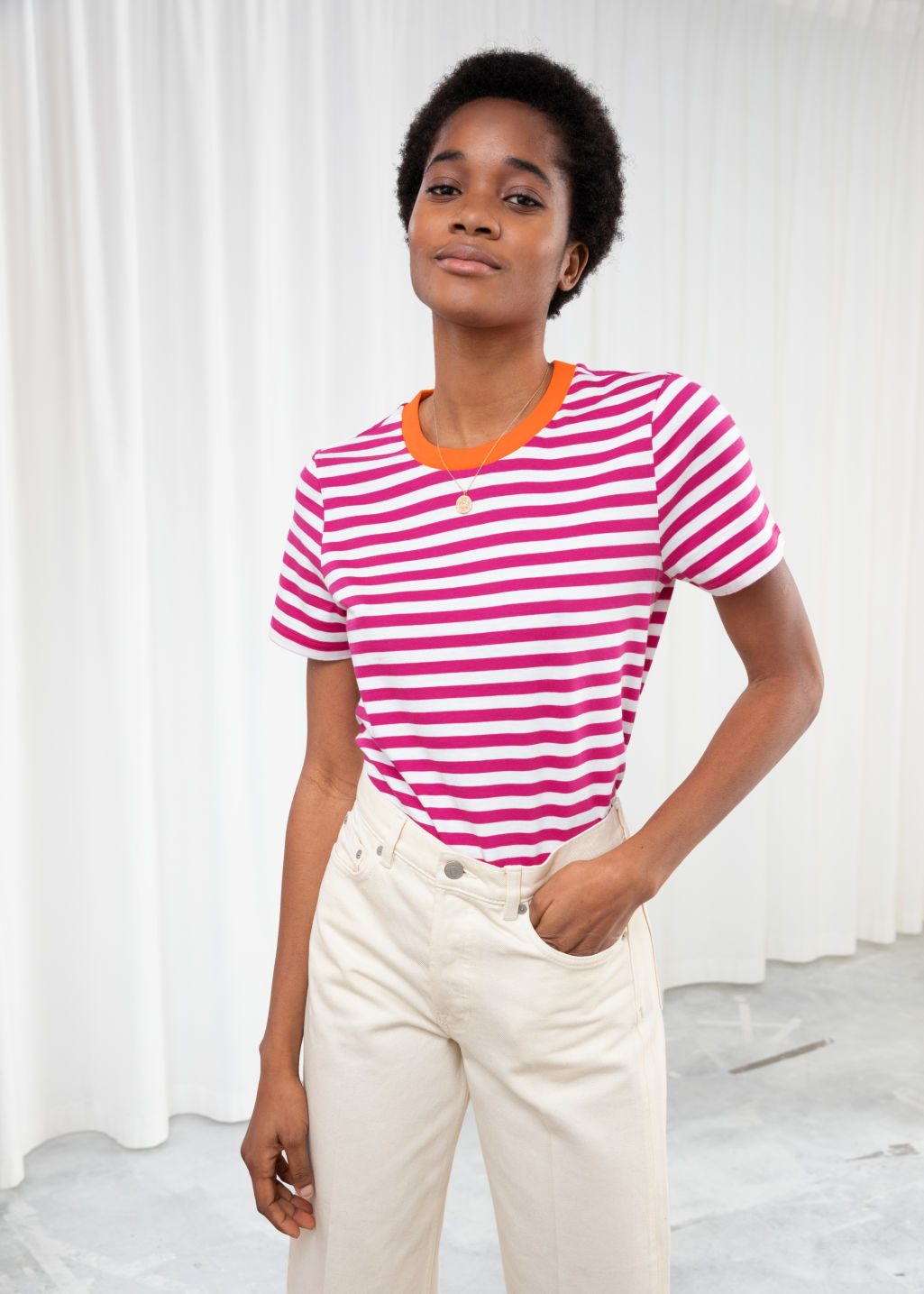 Model front image of Stories striped tee in pink