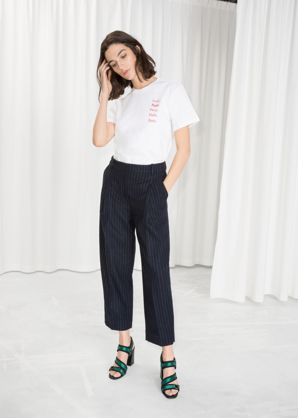 Model front image of Stories pinstripe trousers in blue