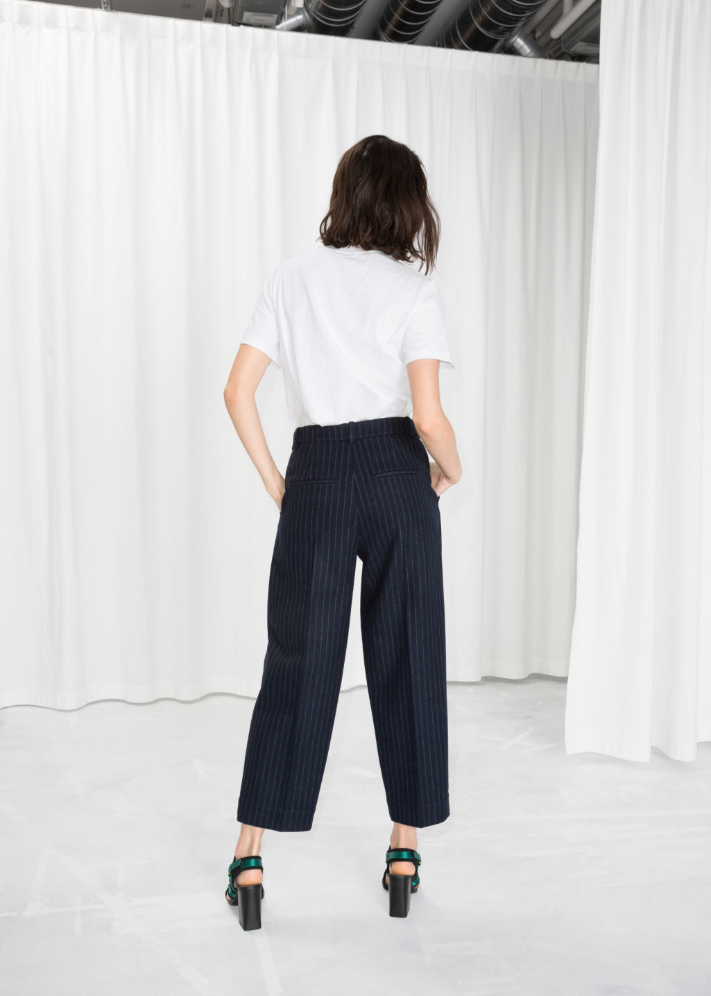 Model back image of Stories pinstripe trousers in blue