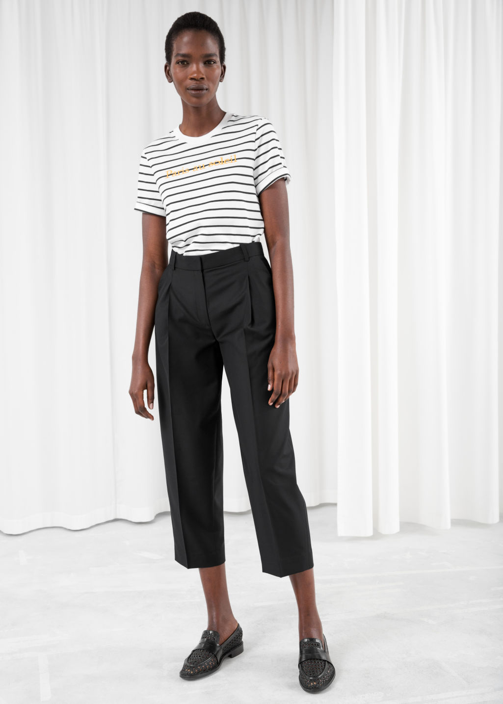Model front image of Stories pinstripe trousers in black