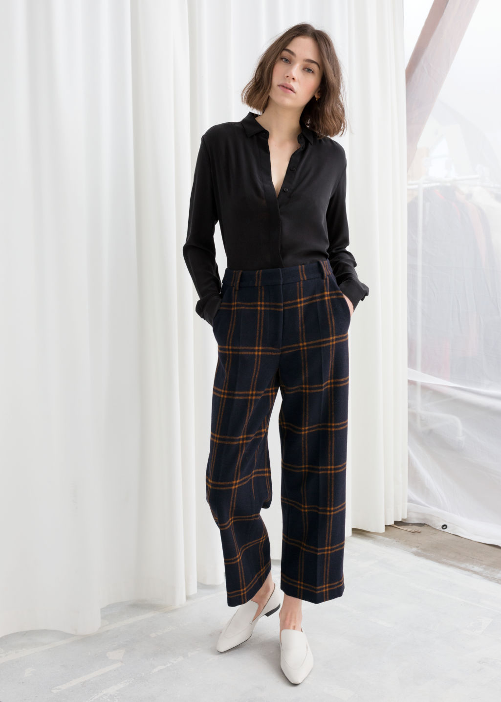 Model front image of Stories cropped wool blend trousers in blue