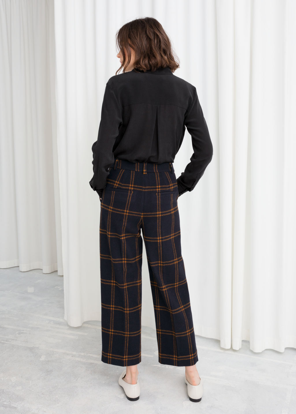 Model back image of Stories cropped wool blend trousers in blue
