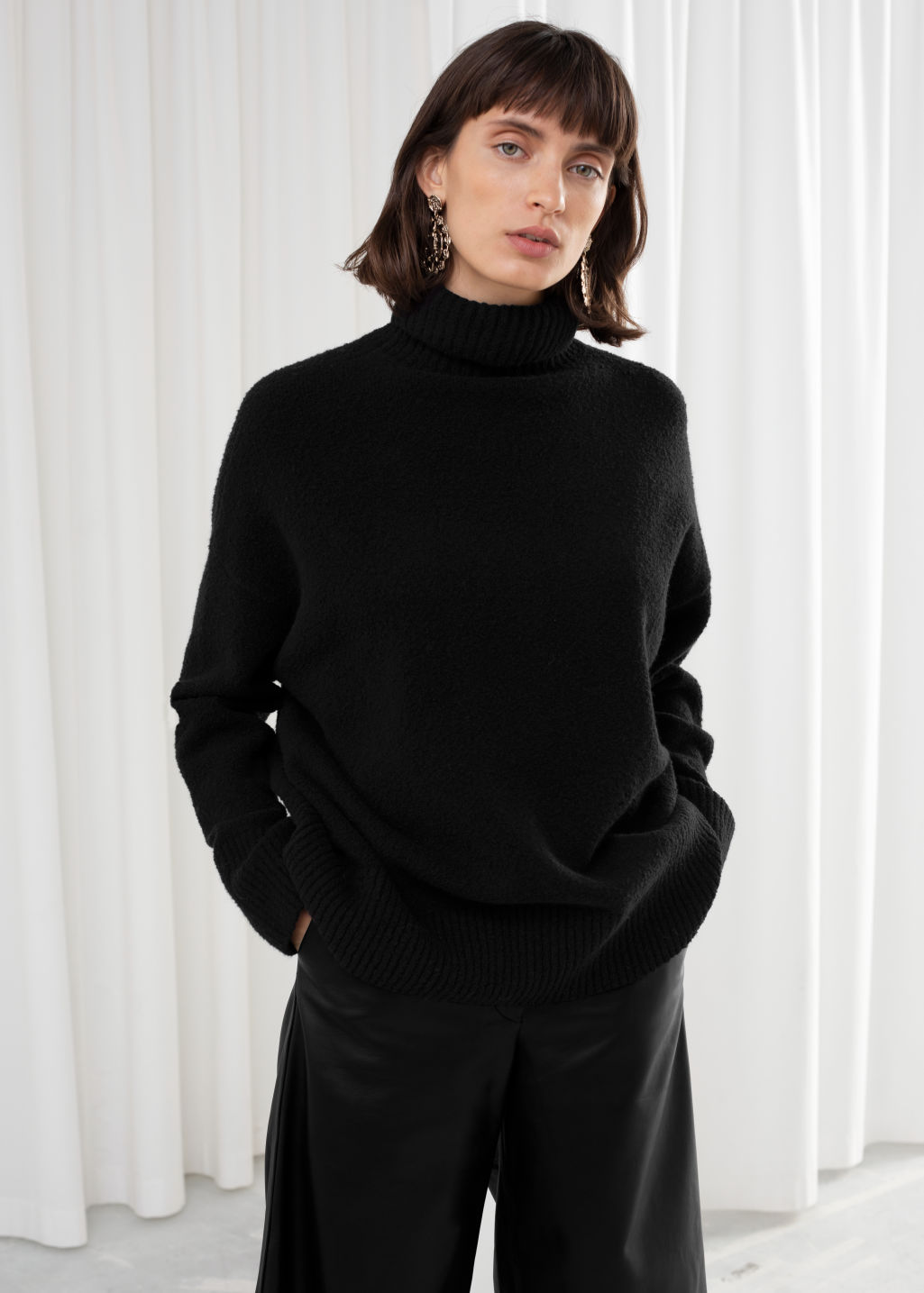 Model front image of Stories high neck sweater in black