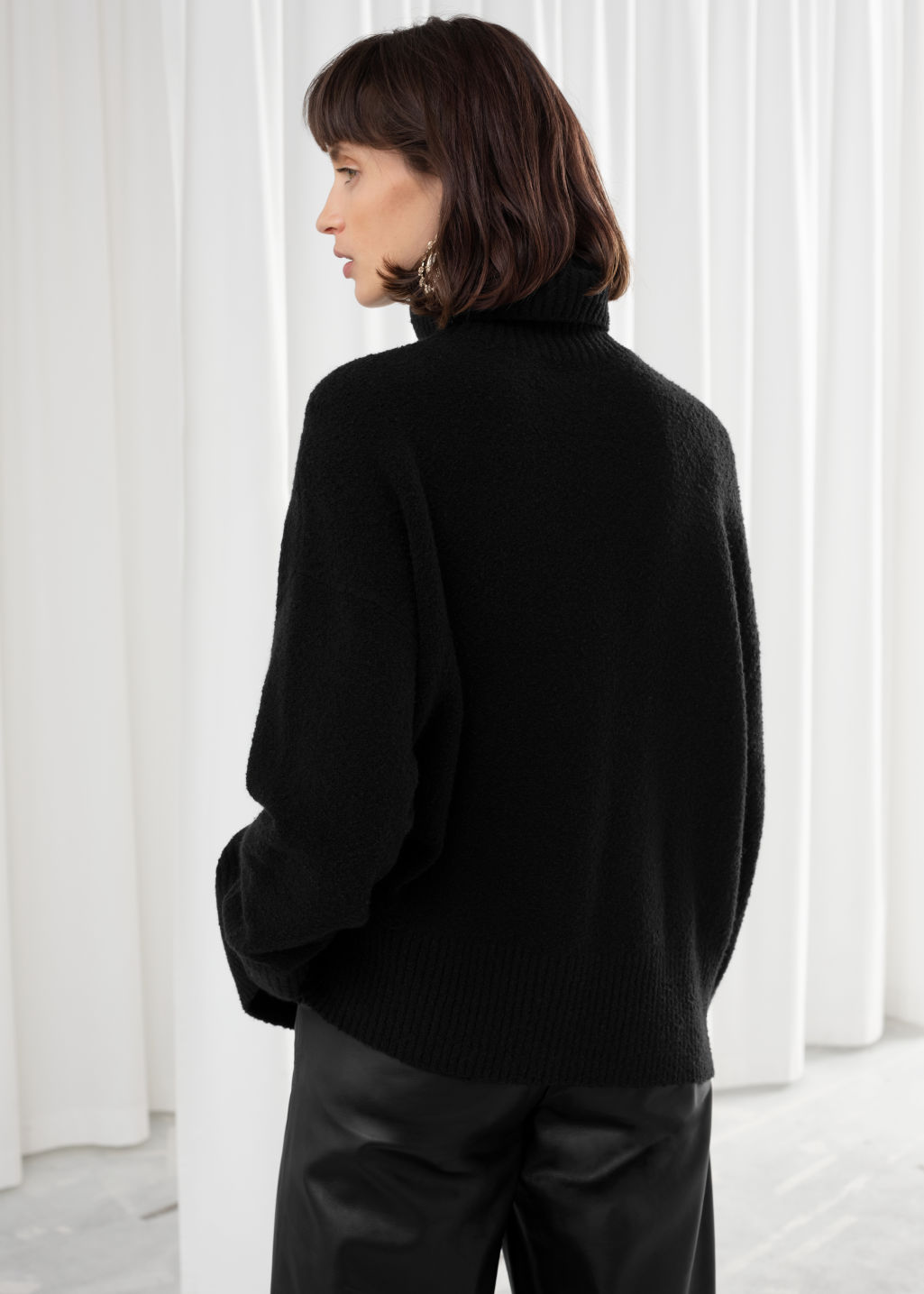 Model back image of Stories high neck sweater in black